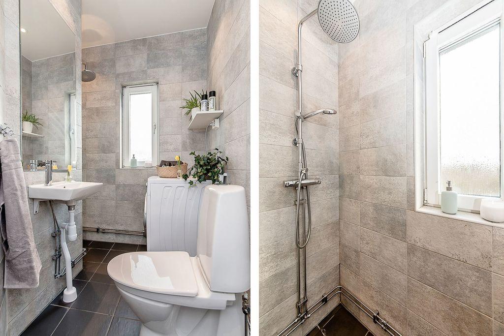 Badrummet med duschhörna och tvättmaskin